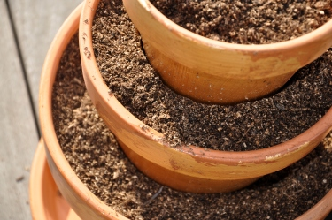 Stacked pots filled with soil