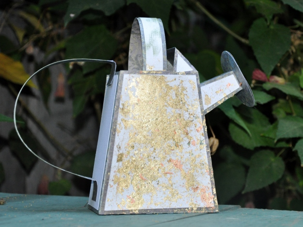 Distressed paper watering can
