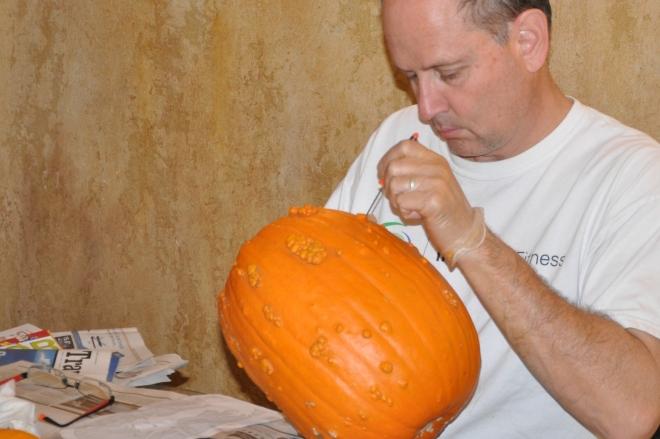 Mike carving pumpkin
