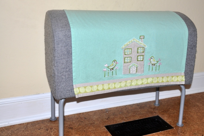 Ikea bench covered with tea towel