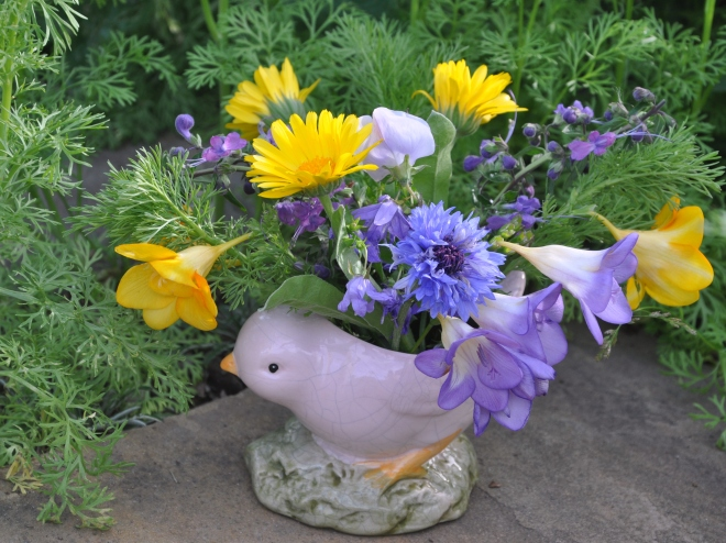 easter flowers in ceramic chick
