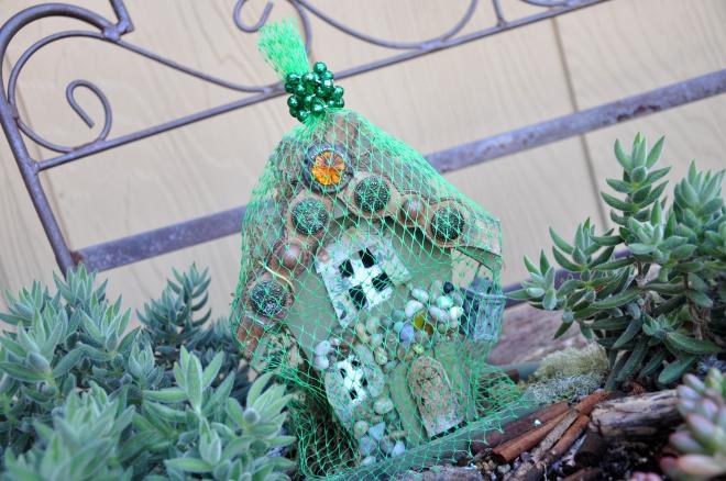 Fairy garden house under a net