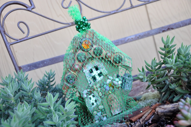 Fairy garden house under a net