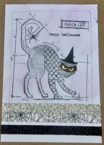 My new stamp blurred when I applied it to the watercolor paper. The quick fix: add a Washi tape mask over the cat's eyes.