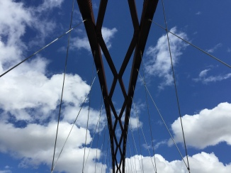Blue skies over the suspension bridge in the park