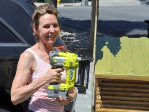Donna attaching the tree pieces with a nail gun