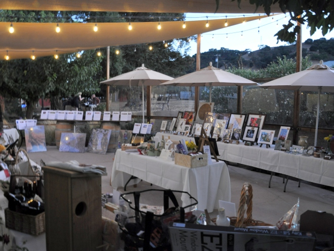 Silent auction items on display at Seeker Vineyard