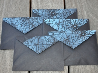 Black envelopes back stenciled with blue ink