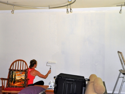 Donna priming the wall