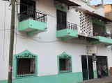 Houses painted with a vivid green trim