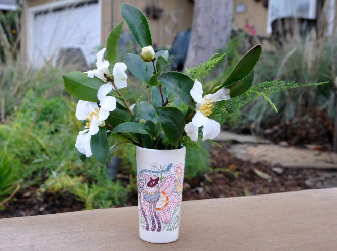 cat vase with camellia and fern