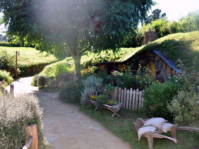 Hobbiton yellow house and wheelbarrow