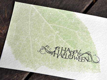 Pumpkin leaf impression on a watercolor postcard
