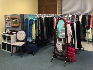 Lifted Spirits boutique: color coded hangers including pink for plus-sizes, blue for dresses and white for the rest