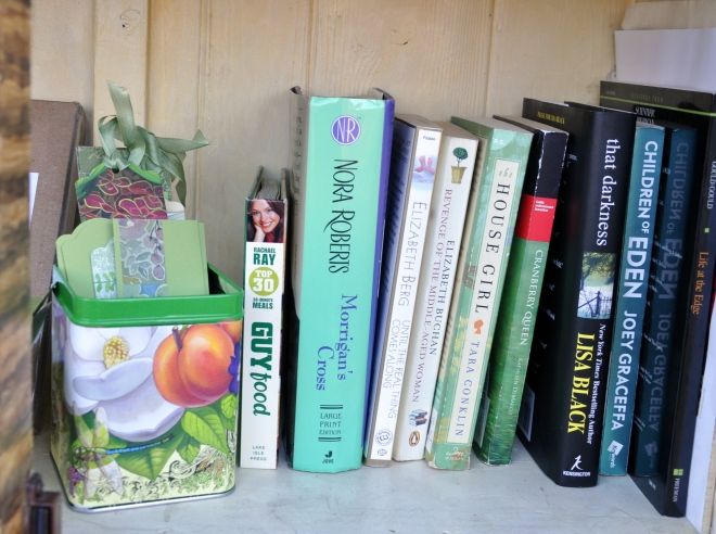 Little Free Library with green books