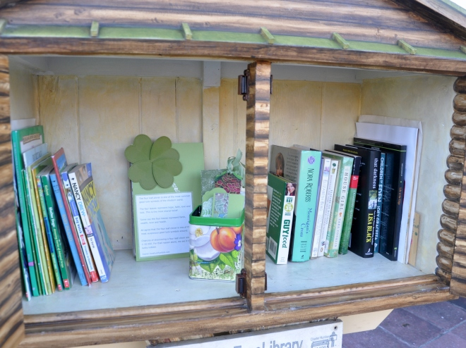Little Free Library with green books and bookmarks