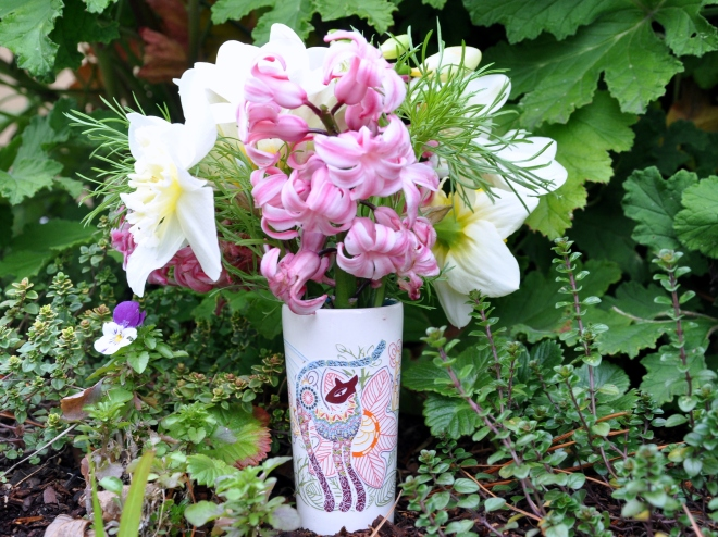 cat vase with spring bulbs
