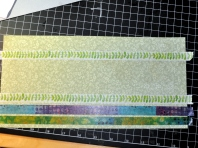 I layered rows of Washi tape across this scrap of green floral