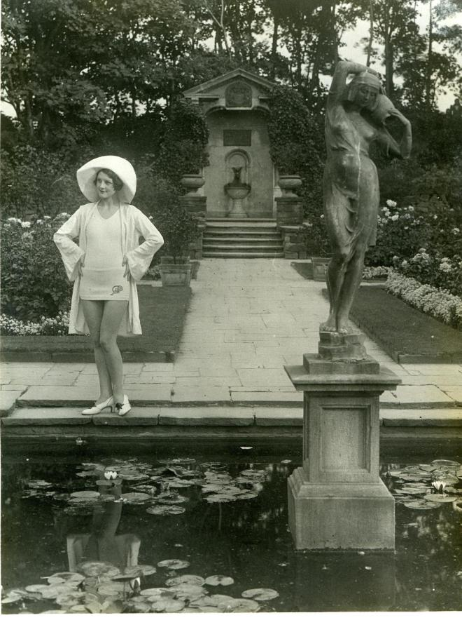 Alys Milner (later Lancaster) posing in a Windsor Wooley bathing costume