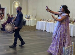 The couple enters dancing