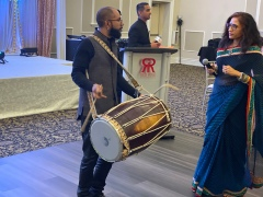 Drumming as the couple enters the room