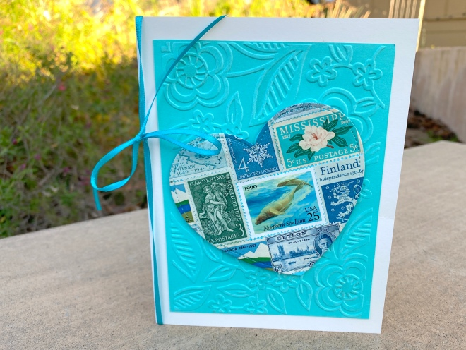 Teal postage stamps heart shaped card