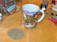 I've had this cat mug since college. I lined the bottom with a circle of scrap foam to cushion the sharp tools.