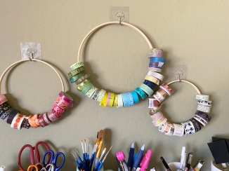 I borrowed this idea from someone in a Facebook Group: Wash tape stored on wooden embroidery hoops